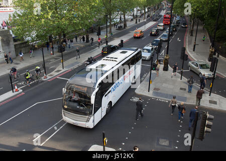 London, England - May 24, 2016: A National Express coach on the Embankment road near Westminster in central London. - Stock Photo
