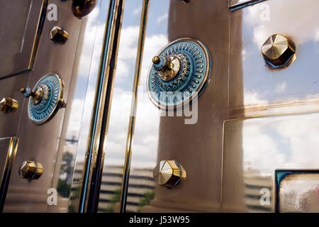 Little Rock Arkansas State Capitol building Tiffany bronze door shiny metal rivets design craftmanship grandeur - Stock Photo