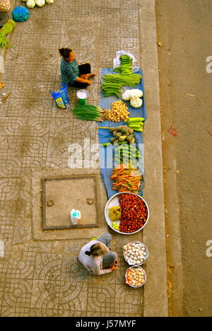 Ladies selling fruit and vegetables on the street, Can Tho, Vietnam - Stock Photo