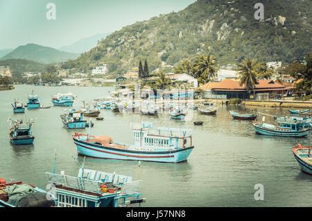 Nha Trang, Vietnam - March 15, 2016: Fishing boats in seaport at Nha Trang, Vietnam. - Stock Photo