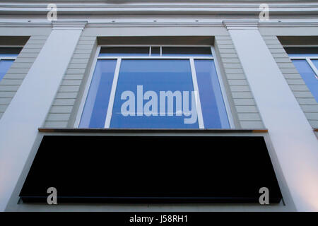 Mock up. Blank billboard outdoors, outdoor advertising, public information board on the wall under window - Stock Photo