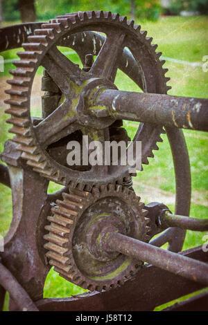 Interlocking cog wheels - Stock Photo