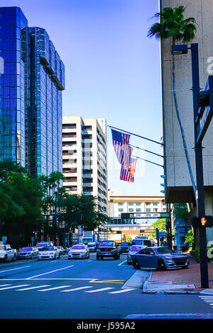 American Flags flying over the sidewalks in downtown Tampa City in Florida - Stock Photo