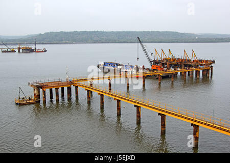 Foundation work for marine structure in full swing in Zuari River in Goa, India - Stock Photo