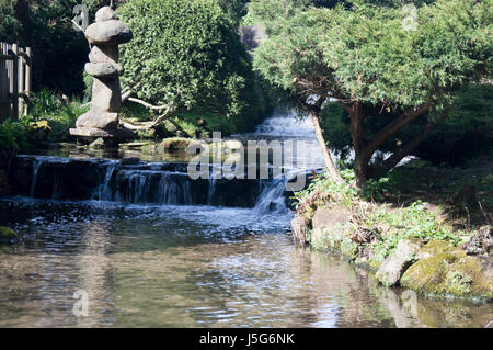 A man made waterfall in the gardens at Newstead Abbey, Nottinghamshire - Stock Photo