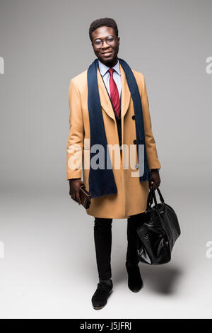 african american businessman travel with bag isolated - Stock Photo