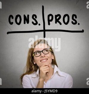 pros and cons, for and against argument concept. Thinking young business woman with glasses looking up isolated - Stock Photo