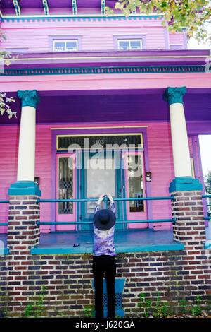 Savannah Georgia Historic District Victorian District Drayton Street house colorful purple violet colorful woman - Stock Photo