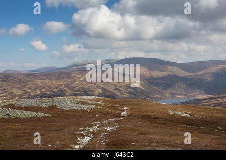 View across the boulder field toward Loch Callater at the summit of Creag Nan Gabhar near Braemar, Aberdeenshire, - Stock Photo