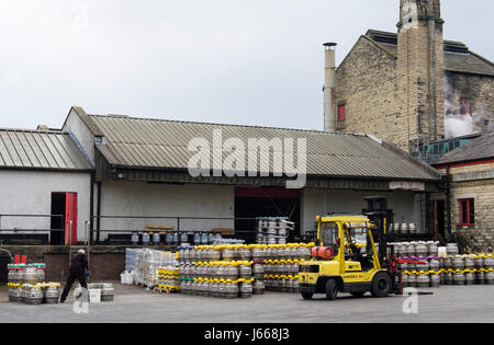 Theakston Brewery with beer kegs in the yard outside. Masham, Wensleydale, North Yorkshire, England, UK, Britain - Stock Photo