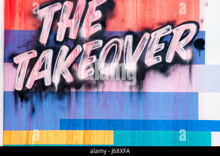 Wall art sign 'THE TAKEOVER'  pained on wall in Wynwood  arts district o0f Maimi. - Stock Photo