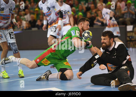 Magdeburg's Jacob Bagersted (L) in action against Göppingen's goalkeeper Primoz Prost during the EHF-Cup semi-final - Stock Photo