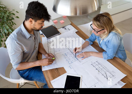 Business People and architects working on project together in office - Stock Photo