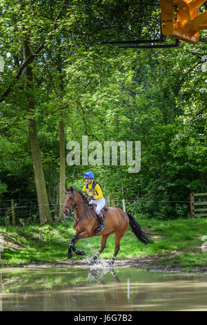 Rockingham Castle, Corby, UK. 21st May, 2017. Richard Evans and his horse Brown Sugar III pass through the water - Stock Photo