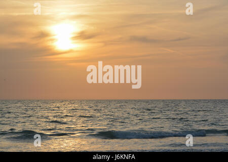 Sunset over the Gulf of Mexico on Indian Rocks Beach in Florida - Stock Photo