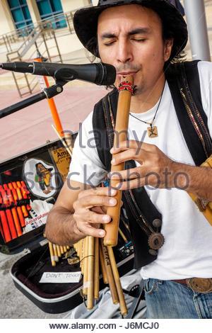 Miami Beach Florida 22nd Street Collins Park Sunday Market Hispanic man plays Peruvian flute microphone - Stock Photo