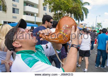 Miami Florida Little Havana Calle Ocho Carnaval Miami annual Hispanic festival man drinking - Stock Photo