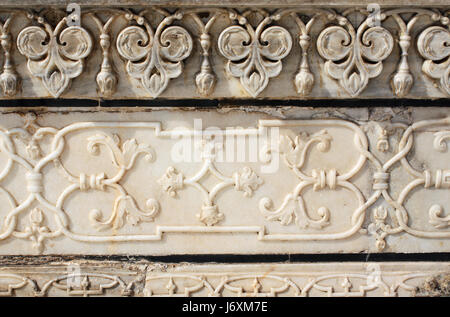 Ancient carved flower on marble in Taj Mahal mausoleum, Agra, India - Stock Photo