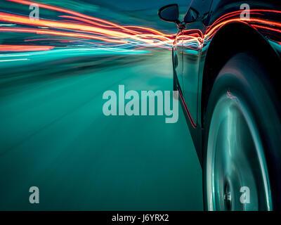 Car driving through traffic - Stock Photo
