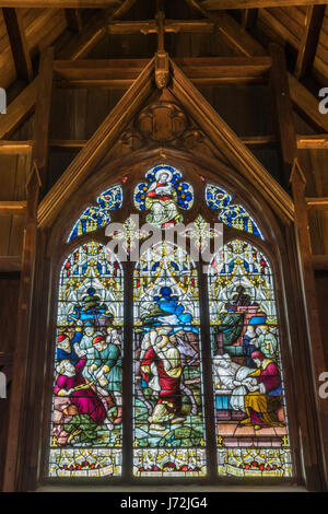 Wellington, New Zealand - March 10, 2017: Inside the wooden Old Saint Paul church shows large elaborate stained - Stock Photo