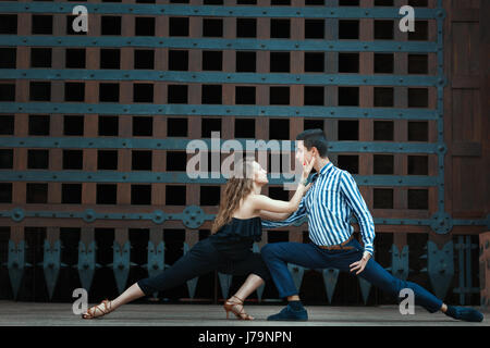 Couple dancing passionate dance. The dancers are young and attractive. See more photos of this series. - Stock Photo