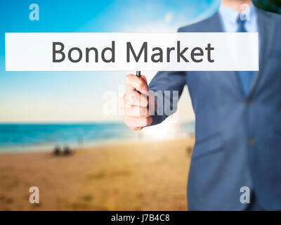Bond Market - Businessman hand holding sign. Business, technology, internet concept. Stock Photo - Stock Photo