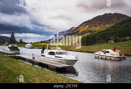 Moored boats at Laggan locks - Stock Photo