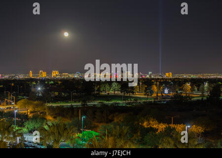 Las Vegas, Nevada, USA - May 13, 2017:  Night view of Las Vegas Strip casino resorts with moon in Southern Nevada. - Stock Photo