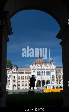 Hungary, Budapest. Parliament Building seen from opposite building with separate sculptures of human beings - Stock Photo