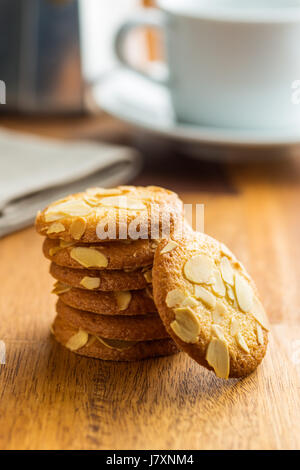Sweet almond cookies on wooden table. - Stock Photo