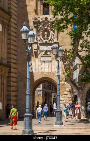 Shoppers and tourist along walk in Place de l'Hotel de Ville, Aix-en-Provence, France - Stock Photo