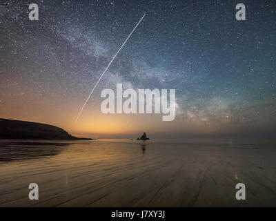 Above Broad Haven beach in Pembrokeshire, Wales. The International Space Station (ISS) is captured travelling across - Stock Photo