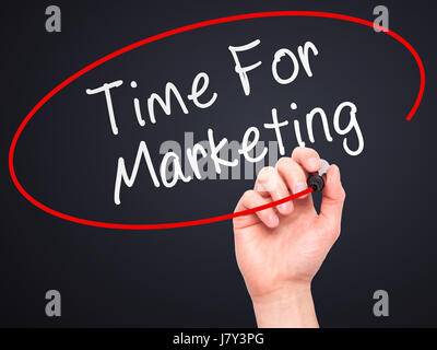 Man Hand writing Time For Marketing with marker on transparent wipe board. Isolated on black. Business, internet, - Stock Photo