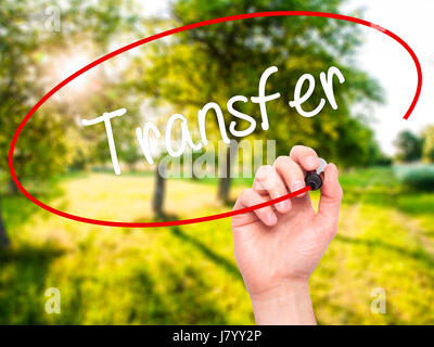Man Hand writing Transfer with black marker on visual screen. Isolated on nature. Business, technology, internet - Stock Photo
