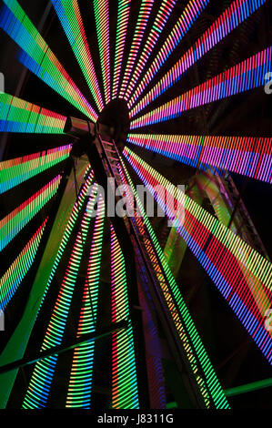 Ferris wheel in motion with multi colors, abstract patterns of colors - Stock Photo