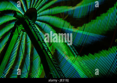 Ferris wheel in motion with multi colors and abstract patterns of colors - Stock Photo