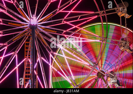 Ferris wheel in motion with multicolors and abstract patterns of colors - Stock Photo