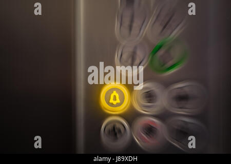 Close up of elevator alarm and panic button on control panel. Button is switched on. Emergency and call for help - Stock Photo