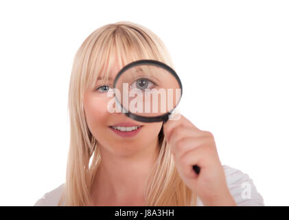 young blonde woman with magnifying glass - Stock Photo