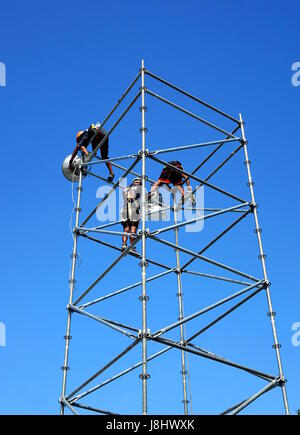 KAOHSIUNG, TAIWAN -- MAY 21, 2017: Workers set up powerful lights on scaffolds in preparation for the upcoming Dragon - Stock Photo