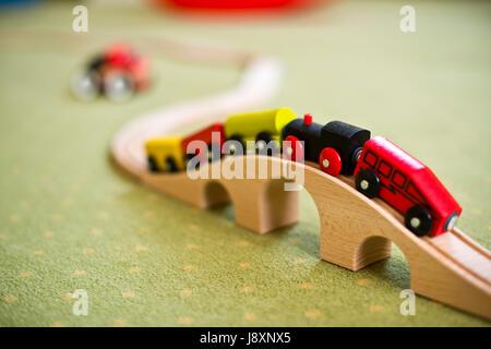 Wooden train toy on a bridge - Stock Photo