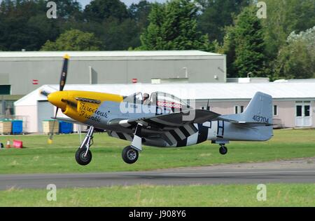 P-51D Mustang fighter Ferocious Frankie, landing during the Dunsfold airshow in Surrey, England on August 23, 2014. - Stock Photo