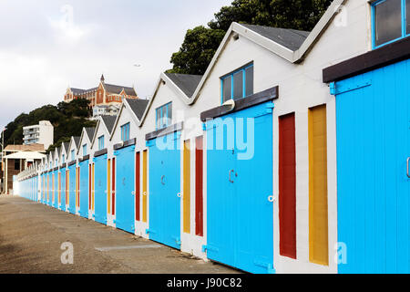 Beach huts / sailing huts Wellington waterfront, Oriental Parade, New Zealand, with monastery in background. - Stock Photo
