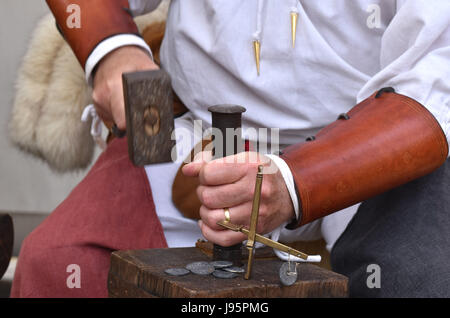 Paris, France. 4th June, 2017. A man in medieval costumes makes coins during a medieval festival in Dourdan, on - Stock Photo