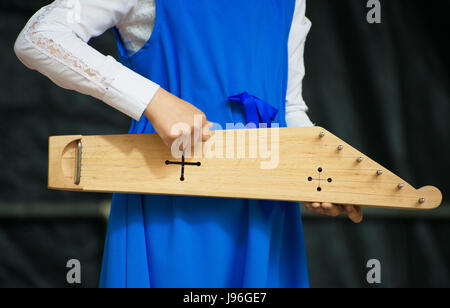 Girl with kannel performing on stage. - Stock Photo