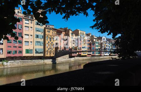 The typical colourful catalan houses in Girona located along the river. Spain, Europe. - Stock Photo