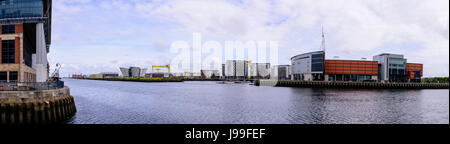 Panorama of Titanic Belfast, Samson, one of the famous yellow cranes, SSE Arena (formerly the Odyssey Arena), and - Stock Photo
