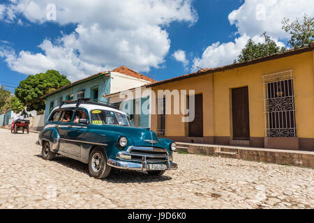 A vintage 1950's American car working as a taxi in the town of Trinidad, UNESCO, Cuba, West Indies, Caribbean - Stock Photo