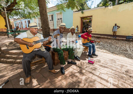 Street performers playing in the city of Trinidad, UNESCO World Heritage Site, Cuba, West Indies, Caribbean, Central - Stock Photo