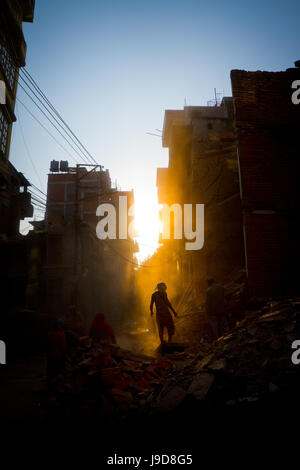 Rays of early evening sun on the dusty streets of Thamel after earthquake, Kathmandu, Nepal, Asia - Stock Photo